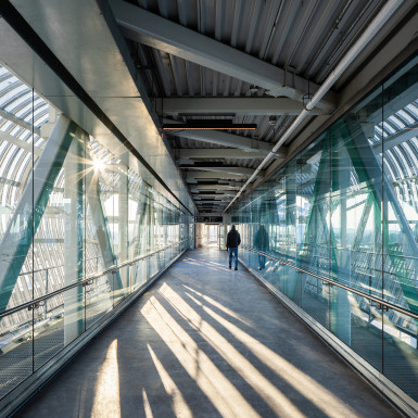 Interior view of the bridge. The bridge provides a vital pedestrian connection to the regions primary transit hub and between the north and south sides of the City of Pickering. Photo by Michael Muraz.