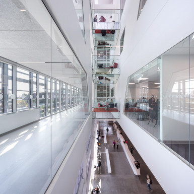 Multi-storey lightwell with bridging study pods. Extensive glazing and multi-storey voids allow circulation through the building to be animated by views to different levels, and, wherever possible, into teaching spaces. Photo by Andrew Latreille.