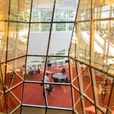 "Wrapped around the oculus, the multi-storey ""Vortex Lounge"" draws students upward into a palpably collaborative environment from the moment they enter the building. Photo by Andrew Latreille."