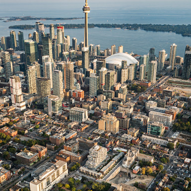 Aerial view of SQ at Alexandra park in the context of Toronto's downtown financial district, with the CN Tower in the background. Photo by Michael Muraz.