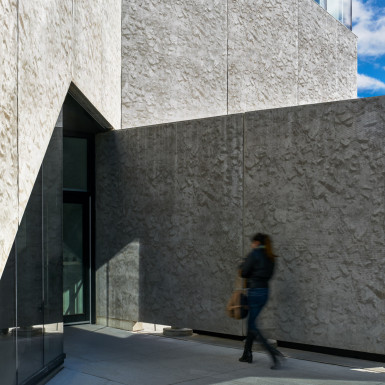 The precast concrete 'ribbon' is folded and sculpted to articulate building entrances. Photo by Andrew Latreille.